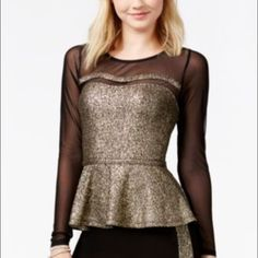 Junior's Long Sleeve Glitter Peplum Top Featuring sheer and flirty sleeves, this black and gold glitter peplum top is sure to turn heads! Scoop neckline • Long Sleeves • Peplum hem • Body: 95% Polyester • 5% Spandex • Contrast: 97% Nylon • 3% Spandex Boutique Tops