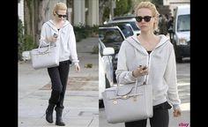January Jones carrying Versace Signature Bag $2675.