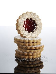 Raspberry-Almond Linzer Cookies | Add ground toasted almonds to the batter to give these beautiful sandwich cookies a fragrant nuttiness.