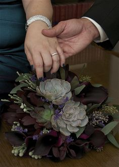 The Purple Pansy flower boutique; A new a trending look for bridal bouquets are succulents. This stunning bouquet consists of: succulents, eggplants calla lilies, leucadendron, limonium, brunia and seeded eucalyptus. Dramatic colours are a perfect match to the untradional wedding gown. Professionally designed by Tricia Xavier, The Purple Pansy flower boutique. Chatham. Ontario. www.purplepansy.ca               519-354-5555 Phyllis Chant Photography