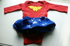 If it's a girl...totes necessary. Wonder Woman Baby Superhero Long Sleeve Onesie Bodysuit with Skirt - 3-6 months. $15.00, via Etsy.