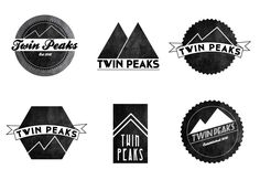 I like the idea of working the double mountain peaks into the logo somehow