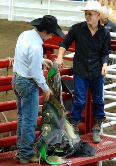Putting on his chaps for the bull riding competition at the North Dakota State Fair in Minot, ND Zippertravel.com Digital Edition