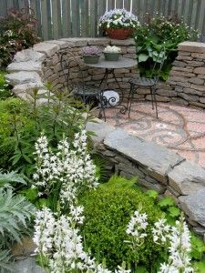 Improving Your Outdoor Patio --  http://www.yourdiyhomedecor.com/improving-your-outdoor-patio/    I like this idea for the front entry way from the driveway, were there would be a small patio seating area.