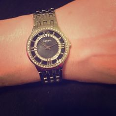 !! Beautiful silver Fossil watch with some bling Beautiful silver Fossil watch with some bling...but not too much! Still very chic and classy. I wore like a bracelet fit, but links can be removed. Needs battery. No box. Authentic. Fossil Accessories Watches