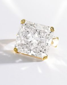 MAGNIFICENT 18 KARAT GOLD AND DIAMOND RING The cut-cornered rectangular modified brilliant-cut diamond weighing 33.84 carats, size 7½, adjus...