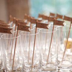 Escort Card Stirrers-Nice idea to just pair cocktail hour into the reception. Then there's no real need for an 'escort card' area.