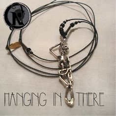 """Thread: BlackColored Glass Beads: Black, Silver, ClearSkeleton: Tibetan Silver Heart: Black GlassMetal Tubes: Silver PlateTag: NTIO/ A.LL. (brass)Size: Fits AllClose-up Photo: Not Actual SizeOur special """"forever"""" thin chord is color fast and waxed to make it super strong and water resistant.  Necklace is 30"""" long -wear it in the shower or the pool. The brass tag is hand stamped with the NTIO Logo on one side and bracelets that support an Artist, Band, Cause, Designer, Event or Group show…"""