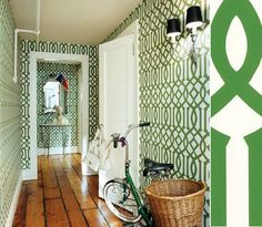 I love that green with the old pine floors and the black shades.  Kelly Wearstler.