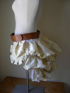 Leather belt and silk frill bustle with secret pockets.