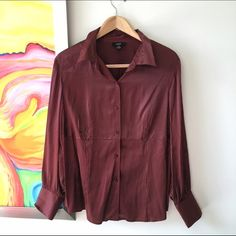 Alfani Silk Micro Dot Blouse Burgundy silk blouse with micro cream colored dots. Feels amazing with a tiny bit of stretch. Has a flattering empire seam. Great under a grey or black suit or paired with jeans. Pre loved Alfani Tops Button Down Shirts