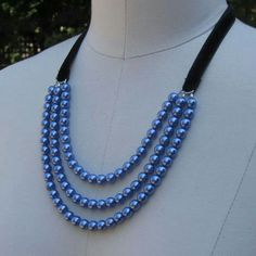 Blue bead and black velvet ribbon necklace.