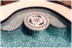 Dolphin Medallion on tabletop in swimming pool