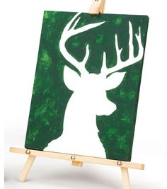 This painted deer canvas is a cute idea for holiday decorating! #simplycreativechristmas
