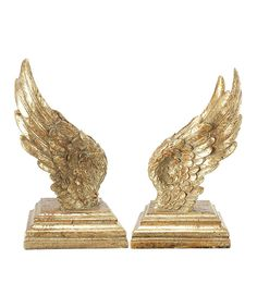 One Allium Way Golden Wing bookends. Aside from keeping your favorite titles from toppling over, bookends offer a fun way to update your decor. Chandeliers, Wings Book, Mythology Books, Golden Wings, Harry Potter, Entryway Console, Entryway Decor, White Decorative Pillows, Decorative Accents