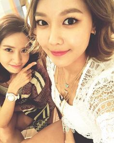 SNSD Yuri, YoonA, and SooYoung snap selfies at their 'Baby G' pictorial