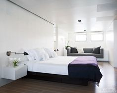 i really like these bed linens. this is on a yacht. doesn't look like a boat at all! interiors designed by john pawson
