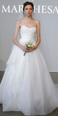 MARCHESA Strapless silk gauze ballgown with draped bodice paired with embellished tulle veil