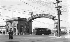 A Key System streetcar passes under the Berkeley sign spanning San Pablo Avenue at the corner of University Avenue, ca. 1925. The sign indicates that the manufacturing district is to the west and the University of California is to the east. (via California Digital Library)