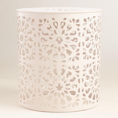 Punched and pierced with a fun floral design, our versatile metal stool is a global-inspired seat for your outdoor space that also doubles as an accent table.