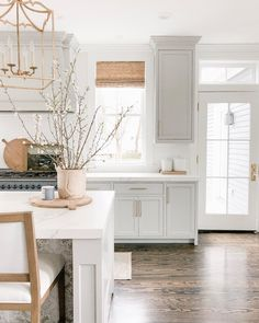 grey kitchen designs Traditional white kitchen design with white kitchen cabinets and large kitchen island with upholstered barstools, cottage kitchen design, white kitchen design Decor, Home Decor Kitchen, Gray And White Kitchen, Kitchen Decor, Hardwood In Kitchen, Home Decor, House Interior, White Kitchen Traditional, White Kitchen Design