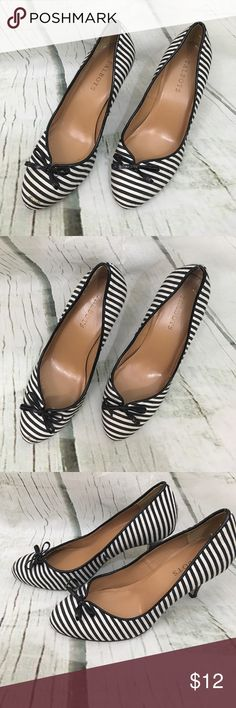 Talbots Heels Black and white striped heels with now in the front. Size 6.5 with 3.5 inch heels. Mark on the front and heel a little worn, both are shown in pictures, good condition otherwise. Talbots Shoes Heels