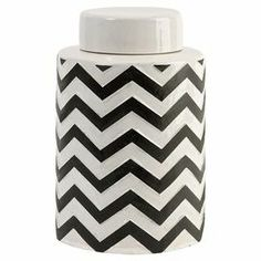 """Create an artful focal point on your mantel or coffee table with this charming lidded jar, featuring a chevron motif in black and white.   Product: Lidded jarConstruction Material: CeramicColor: Black and whiteDimensions: 9.25'' H x 6.25"""" Diameter"""