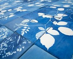 via Design*Sponge || the studio glithero team created tiles and vases that were treated with light sensitive chemicals. after strapping flowers the surface of each object and exposing them to the light, the glithero designers created beautiful sunprint pieces that finish to be a bright prussian blue.