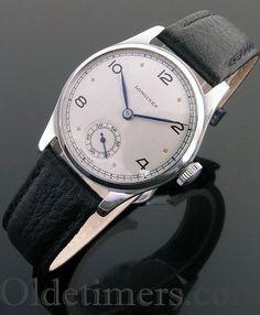 A steel round vintage Longines watch, 1940s