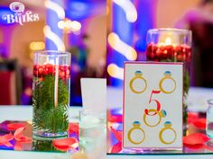 Love these Christmas themes center pieces with blue uplighting for the room!