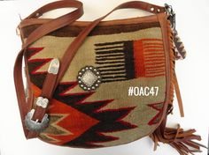 Large Saddle Bag made of fine leather and fragment of vintage Navajo rug.  Produced in U.S.A.  Find more designer handbags at www.pccohandbags.com