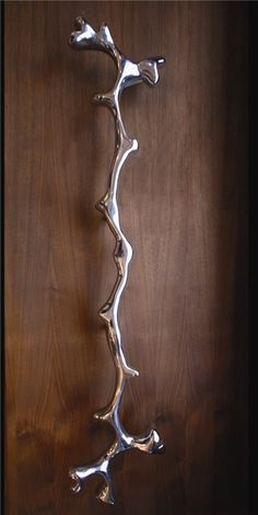 Aluminium CoralLarge sculptural pull handle, can be used singularly or in pairs. Available in either bright polish or satin brushed finish.By Phillip Watts Design.