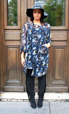 Blue and yellow, feather patterned, loose fitting over top, styled with black trousers and black tasselled boot by Lili La Tigresse.