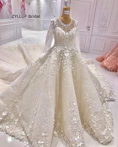 Best  from China wedding gowns Suppliers ZYLLGF Bridal Saudi Arabia Wedding Dress Ball Gown O Neck Appliques Long Sleeved Wedding Gowns With Cathedral Train