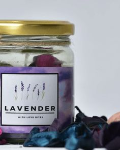 Beautiful Handmade Candle , infused with Lavender fragrances and with beautiful lavender scented potpourri .