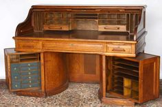 Wooton oak roll top desk with rotary sides. The rotary desk was patented in 1876 and also displayed at the Philadelphia Centennial. The desks were commended for compactness, convenience, and utility.    The Rotary desks came in twelve styles, including a single or double pier pedestal, with a flat or slanted writing surface. Rotary desks were made in two grades; Standard and Extra Grade. The prices ranged from 30 to 225 dollars.