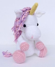 Beautiful unicorn by Jenna at YouHadMeAtCrochet. Used horse pattern by Little Muggles (changed colors and added a horn!)