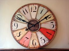 Cool clock, but I can imagine doing this with paint chips instead of the solid colors... That would look very interesting.