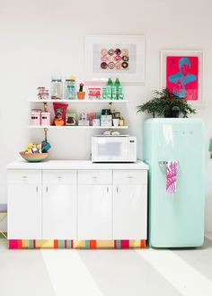 Joy Cho of Oh Joy! | The Everygirl // studio tour // office kitchen // turquoise Smeg refrigerator // photo by Kimberly Genevieve