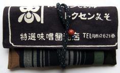 新物ですが、醤油屋の前掛けの絵柄の市販の生地と、縞の藍染の着物と、柿渋で染めた大漁旗、地模様入りの黒の正絹の羽織を組み合わせました。自分で染めた大漁旗です。染...|ハンドメイド、手作り、手仕事品の通販・販売・購入ならCreema。