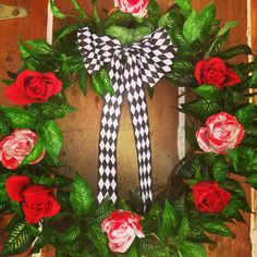 This is my Alice in Wonderland wreath I made for less than $30! Simple, yet it gets the point across. -- Ari