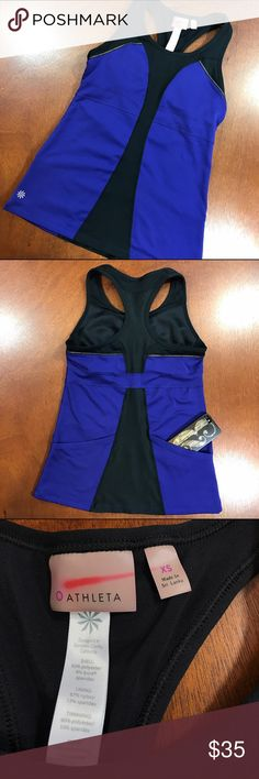 ATHLETA Racerback Workout Tank Kick of the new year with this great Athlete Tank. Built in bra, and 2 back pockets, perfect for stashing a phone or snack during a bike ride. New Condition Athleta Tops Tank Tops