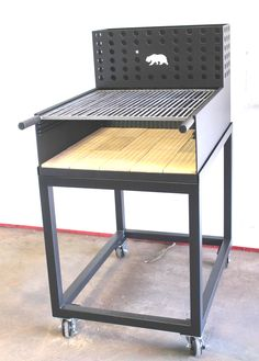 Goldilocks, a small, patio friendly Umbrian Grill, brick lined with a rear brazero or ember maker. Made by NorCal Ovenworks Inc.