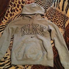 Nike Sweater It's gray, perfect condition, no ripping, nothing faded. You'll love it! I'm selling it for $40, but I can compromise! Just message me and we will work it out, I'm really easy to work with!! Nike Sweaters