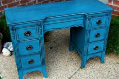 Antique vanity desk in distressed Peacock Blue and Black Glaze.  Original hardware.