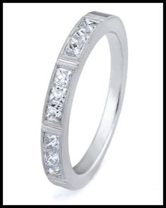 The Isabella wedding band with French cut diamonds and millegrain details. From Erika Winters' Fidelia collection.