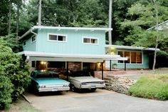 A mint ranch style house with a carport and matching mint car