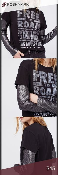 "Free People Backstage Graphic Tee Sequin Sleeves Free People Backstage Tee Sequin Long Sleeves  ""Free to Roam"" size S Color Black with silver sequins allover the sleeves Edgy layered tee featuring statement sequin long sleeves. Retails at $78 Sold Out in stores.  Faded graphic Subtle distressed trim Soft cotton tee Measurements Bust : 41 in Length: 27.25 in Sleeve Length: 24 inch Free People Tops Tees - Long Sleeve"