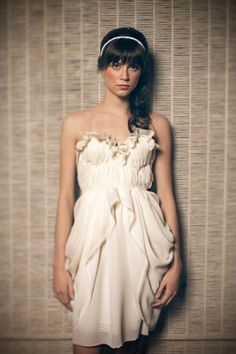 ivory dress.: this is originally a bridal dress, but i think it's not like the other pretty little white bridal dress. it's short, silk, and ivory. :)