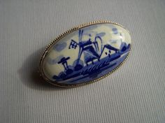 Vintage Blue Delft and Silver Brooch. $17.00, via Etsy.